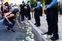 Protesters lay flowers at the feet of Chicago Police Department officers on June 06, 2020 in Chicago, Illinois.