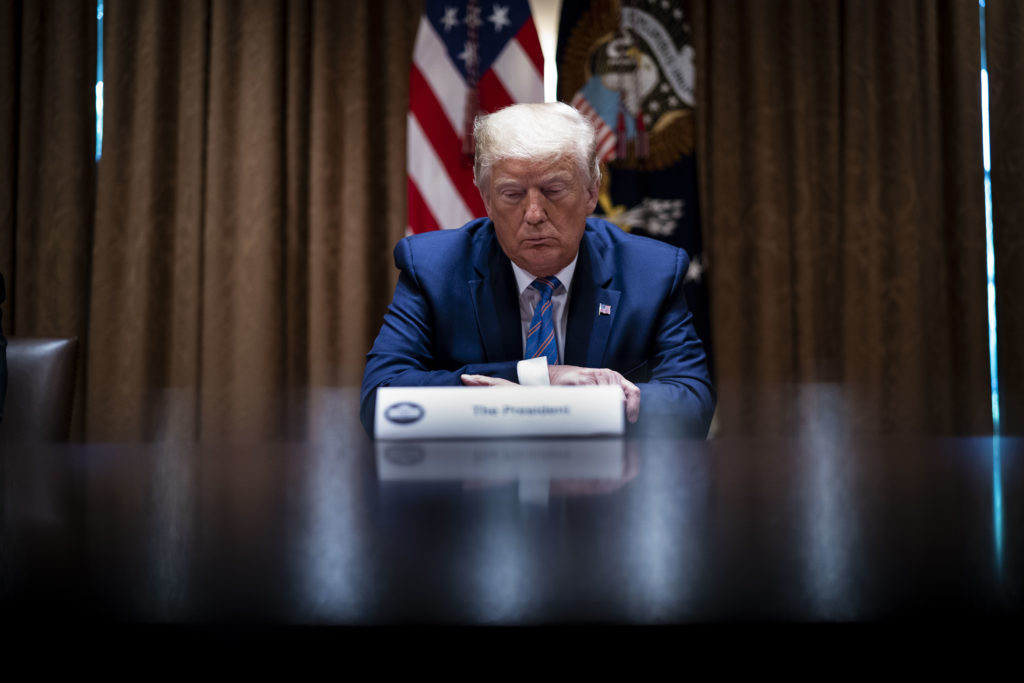 "President Donald Trump listens during a roundtable on ""Fighting for America's Seniors"" at the Cabinet Room of the White House June 15, 2020 in Washington, DC."