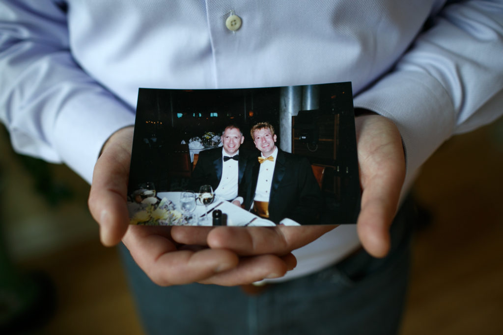 Jim Obergefell holds a photo of him and his late husband John Arthur in his condo in Cincinnati, on April 2, 2015. (Maddie McGarvey/For The Washington Post via Getty Images)