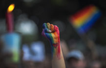 A defiant fist is raised at a vigil for the second-worst mass shooing in US history, the Pulse nightclub shooting, on June 13, 2016. (David McNew/Getty Images)