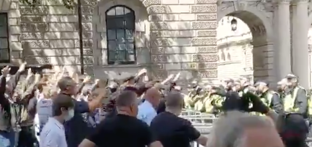 Startling video showed a gang of far-right white-supremacists flashing Nazi salutes during a riot to defend a statue of Winston Churchill, who famously defeated the Nazis. (Screen capture via Twitter)