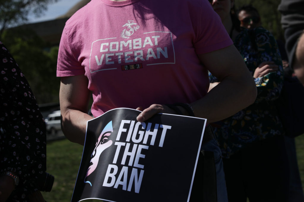 Democratic lawmakers joined activists to rally against the transgender military service ban.