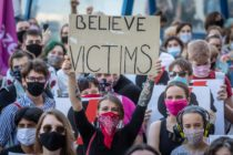 A protester holds a banner reading Believe Victims as she takes part in a protest against the Polish government plans to withdraw from the Istanbul Convention