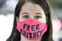 A #FreeBritney supporter wearing a pink face mask