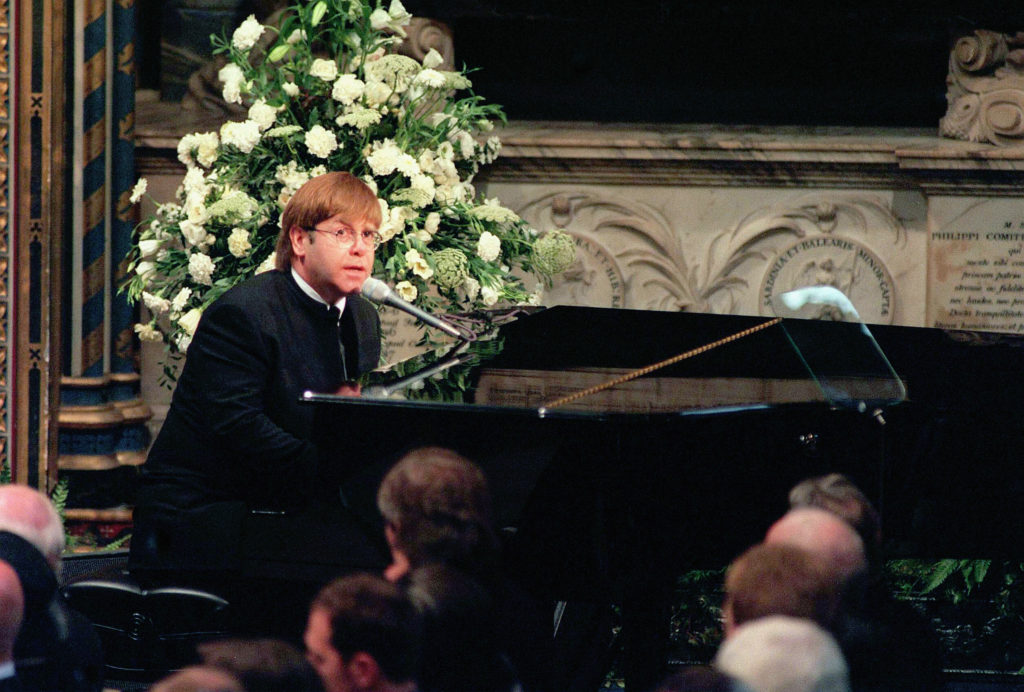 Elton John sings 'Candle in the Wind' at the funeral of Diana, Princess of Wales. (Anwar Hussein/Getty Images)