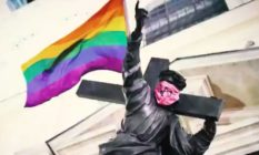 Jesus statue with rainbow flag and anarchist bandana