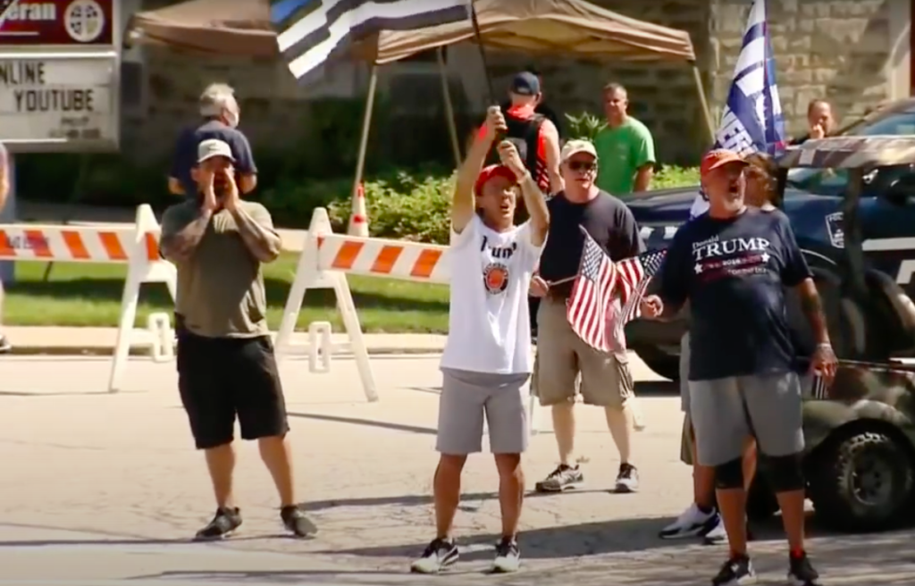"""Back the Blue"" counter-protesters in Shaler Township, Pennsylvania, only feet away from a Black Lives Matter demo. (Screen capture via Youtube/CBS Pittsburgh)"