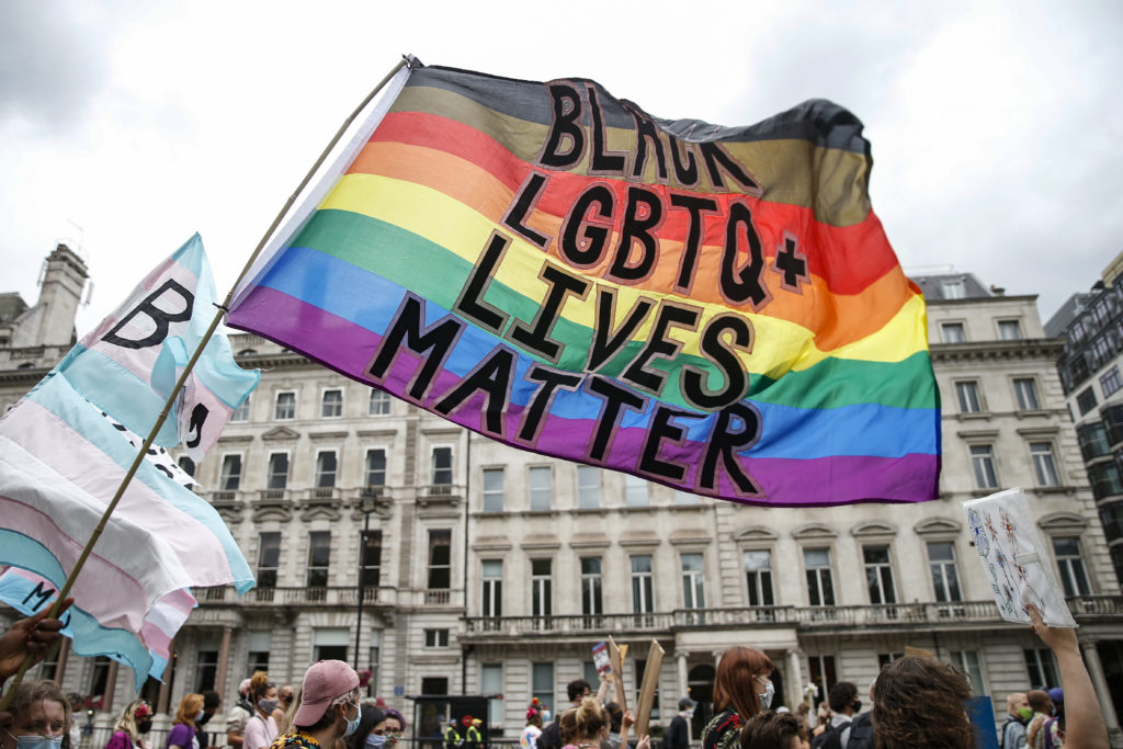Pride flag with text: Black LGBT+ Lives Matter covid-19