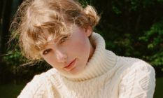 Taylor Swift wearing a cream roll neck jumper with soft curls (mid shot) queer betty