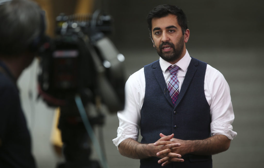 Cabinet Secretary for Justice, Humza Yousaf, has forwarded new hate crime legislation that, he said, would not lead to JK Rowing being prosecuted for sharing her anti-trans views online. (Fraser Bremner-Pool/Getty Images)