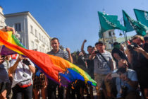 Far-right protesters attempt to burn a rainbow flag as they protest against the LGBT community on August 16, 2020 in Warsaw, Poland.