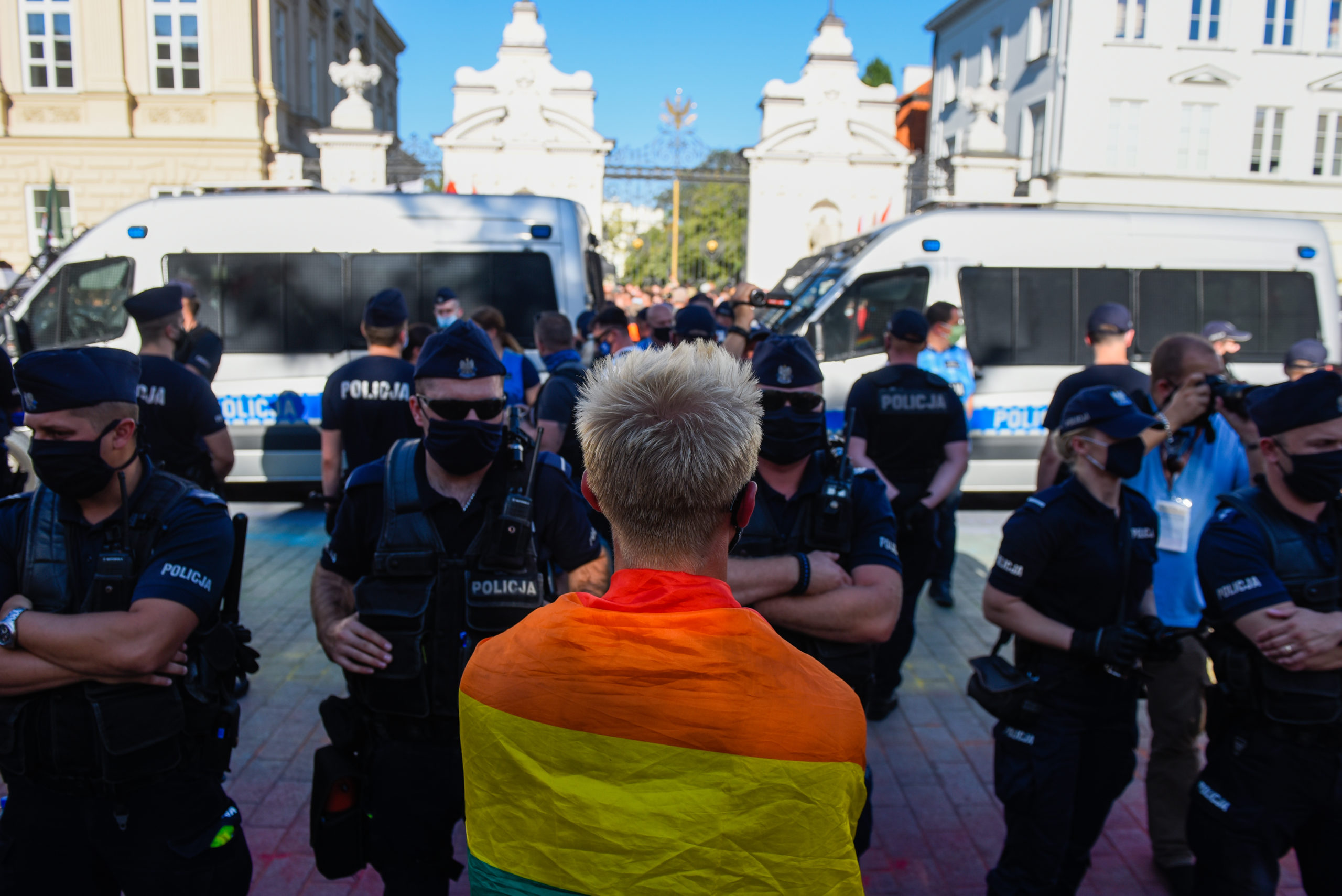 An LGBT activist wears a rainbow flag during a counter protest against an anti-LGBT far right rally on August 16, 2020 in Warsaw, Poland.