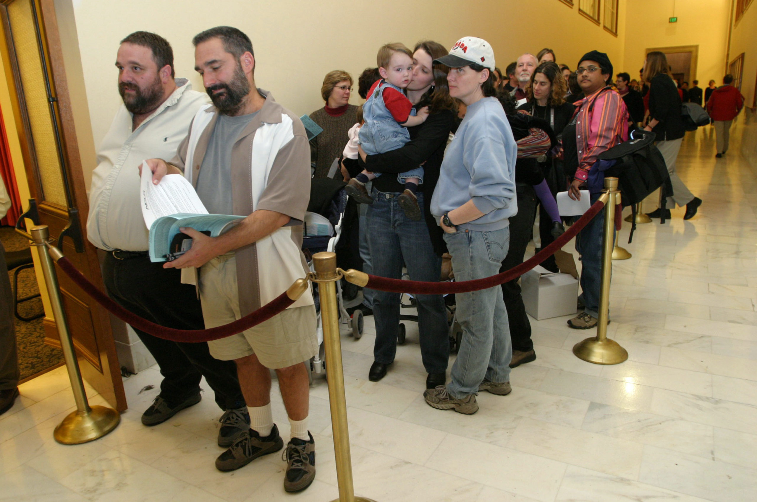 Hundreds of gay couples line up in front of the County Clerk's office at San Francisco City Hall to register for marriage forms on February 13, 2004