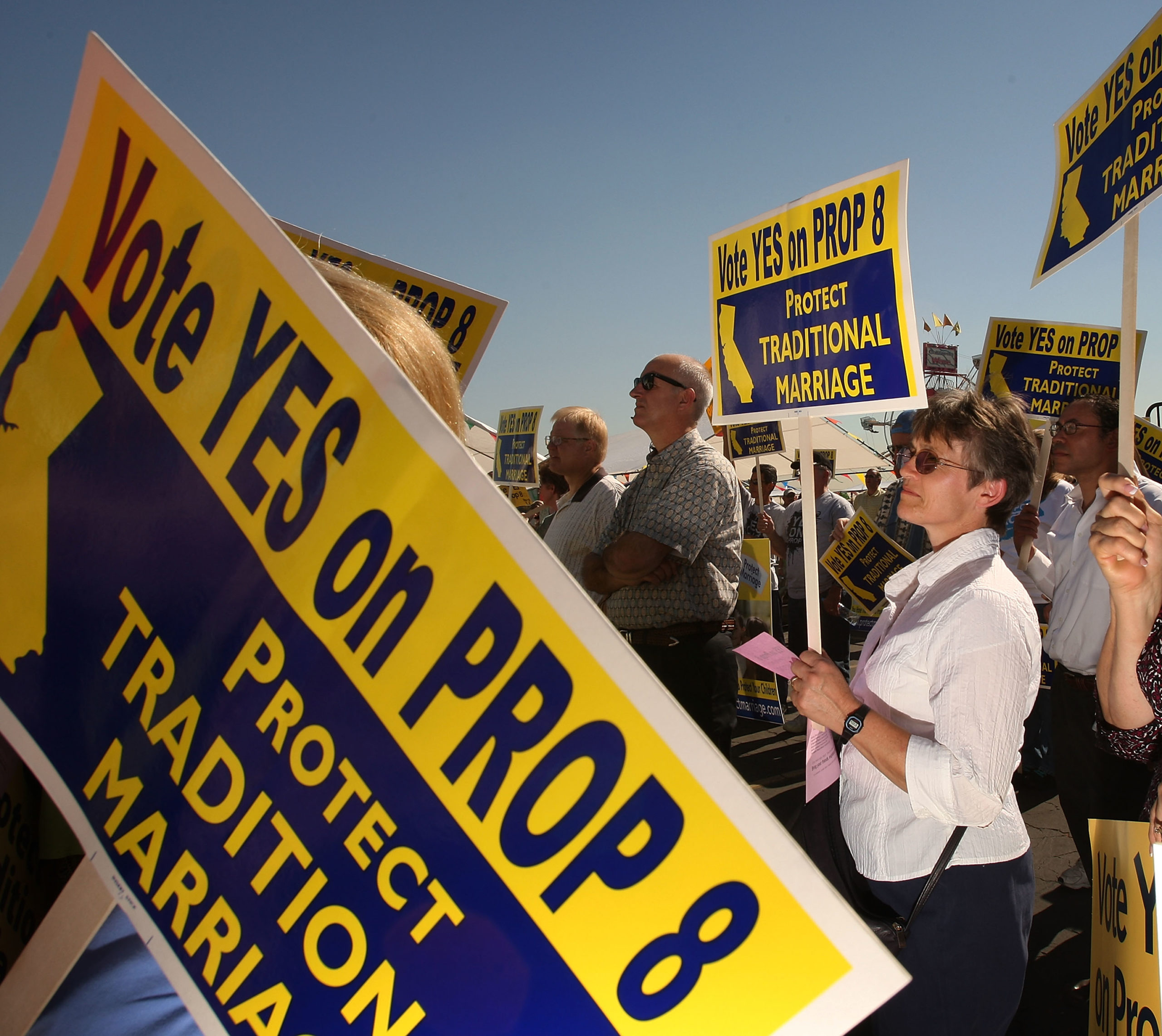 Supporters of Proposition 8, which would outlaw same-sex marriage throughout California, rally during a 'Yes on 8 bus tour in Los Angeles, California.