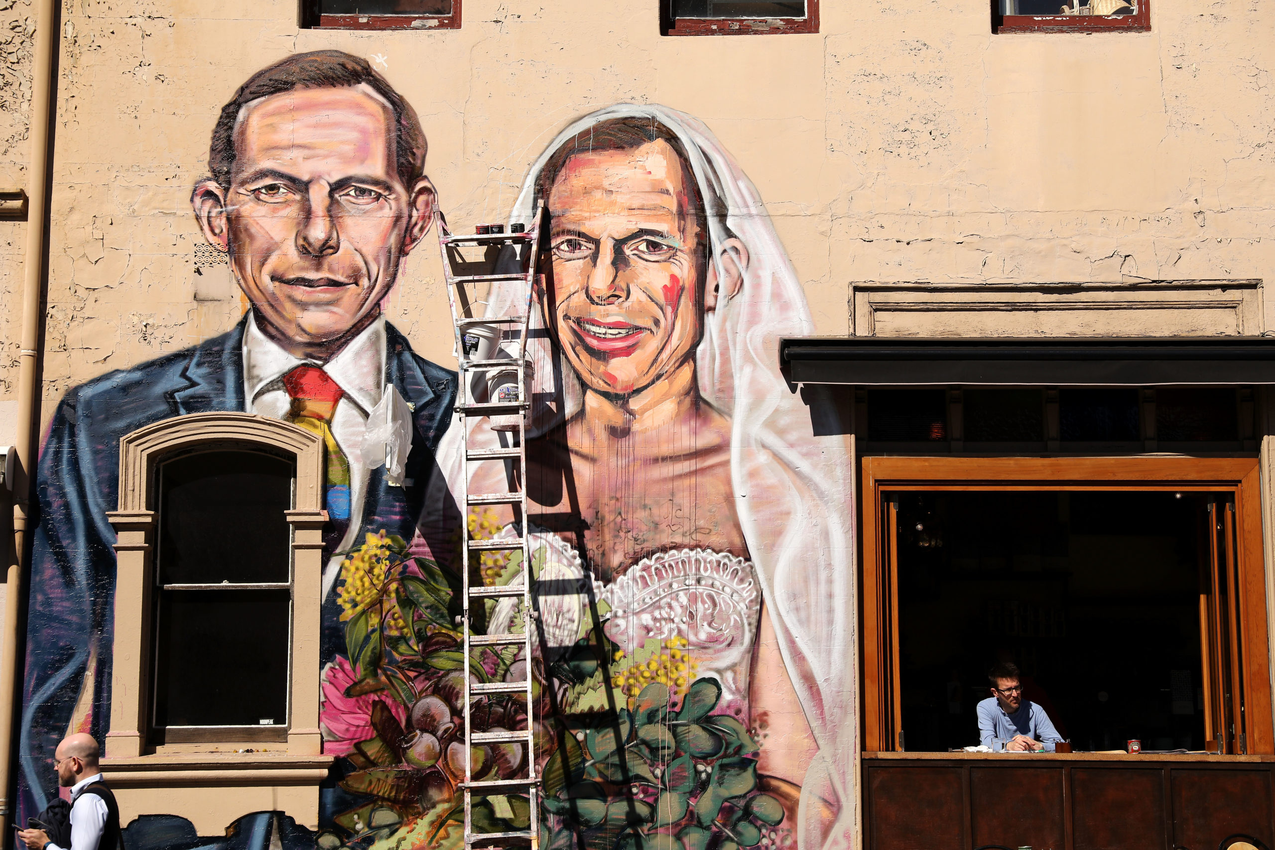 A mural by artist Scott Marsh depicting former Prime Minister Tony Abbott marrying himself