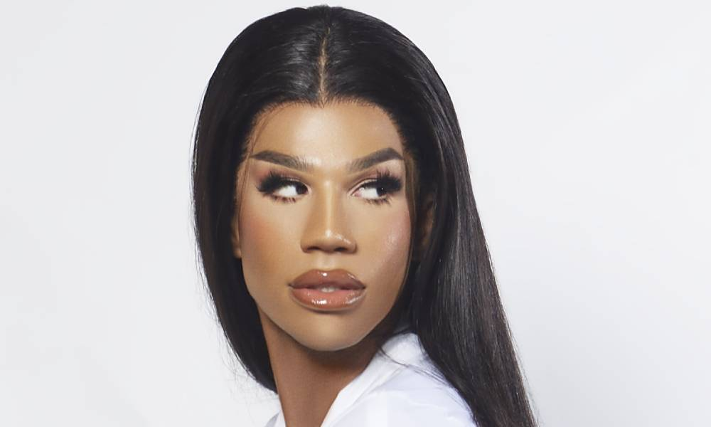 A tight crop of Naomi Smalls' face. Her hair is long, her mug is beat, her eyes looking to the right