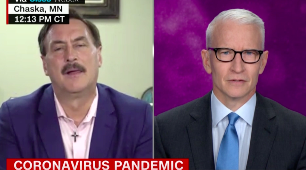 Anderson Cooper (R) tore into Mike Lindell for peddling an unproven cure to the coronavirus. (Screen capture via Twitter/CNN)