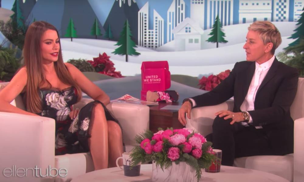 Sofia Vergara and Ellen DeGeneres sitting on white armchairs on the set of the Ellen show