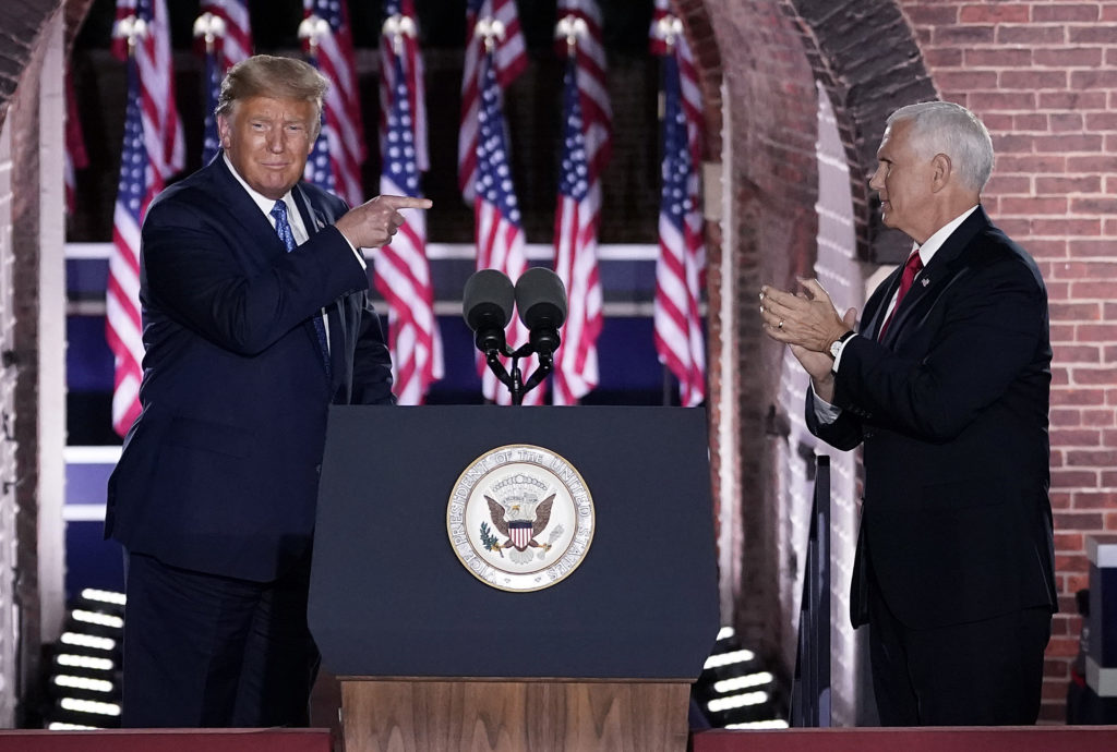 Donald Trump pointing at Mike Pence on stage
