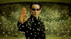 Neo holding up his palm to stop a raft of bullets