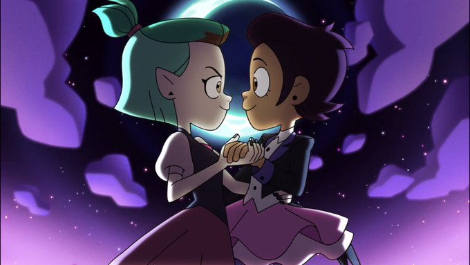 The Owl House's Luz and Amity dancing at prom, holding hands and looking at each other lovingly