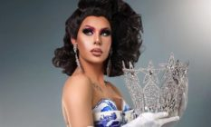 Trinity the Tuck holding her Drag Race crown