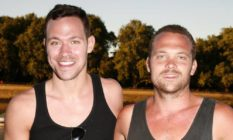 Will Young and brother Rupert wearing vests, smiling