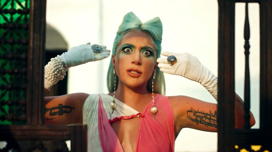 Lady Gaga, more talented than Da Vinci and Da Vinky combined, in the music video for '911'. (Screen capture via YouTube)