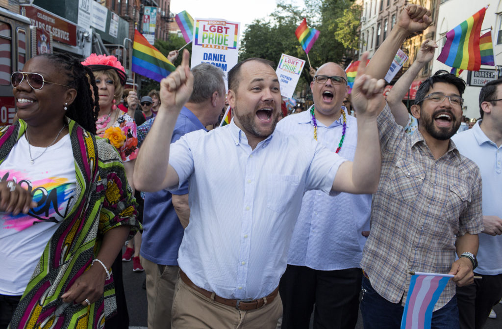 New York City Council Speaker Corey Johnson dances with other members of the city council at Brooklyn's annual LGBT+ Pride Parade. (Andrew Lichtenstein/Corbis via Getty Images)