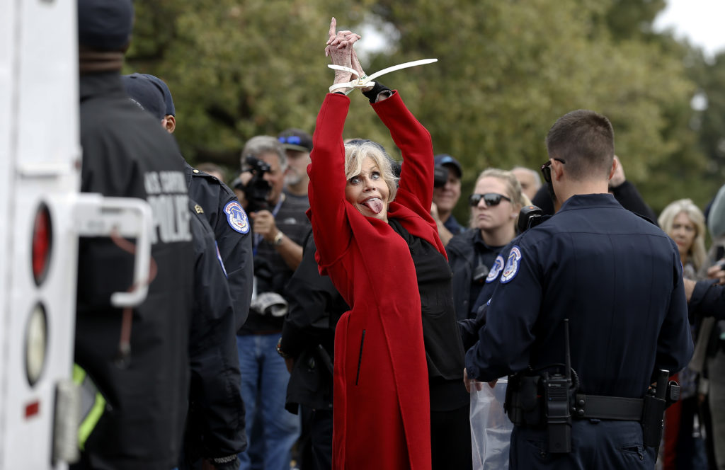 """Jane Fonda is arrested during the """"Fire Drill Friday"""" Climate Change Protest on October 25, 2019 in Washington, DC. (John Lamparski/Getty Images)"""