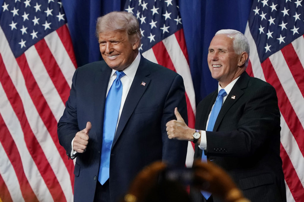 President Donald Trump and Vice President Mike Pence give a thumbs up after speaking on the first day of the Republican National Convention