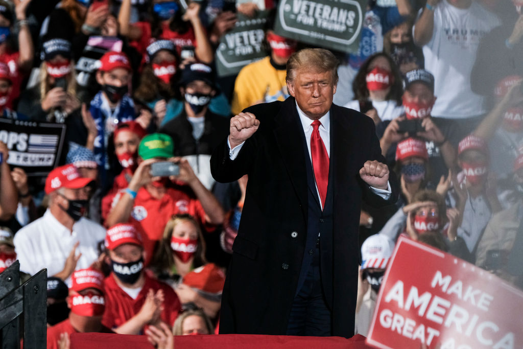 President Donald Trump charges up the crowd while speaking of the need to win the upcoming election during a campaign rally at the Toledo Express Airport on September 21, 2020 in Swanton, Ohio.