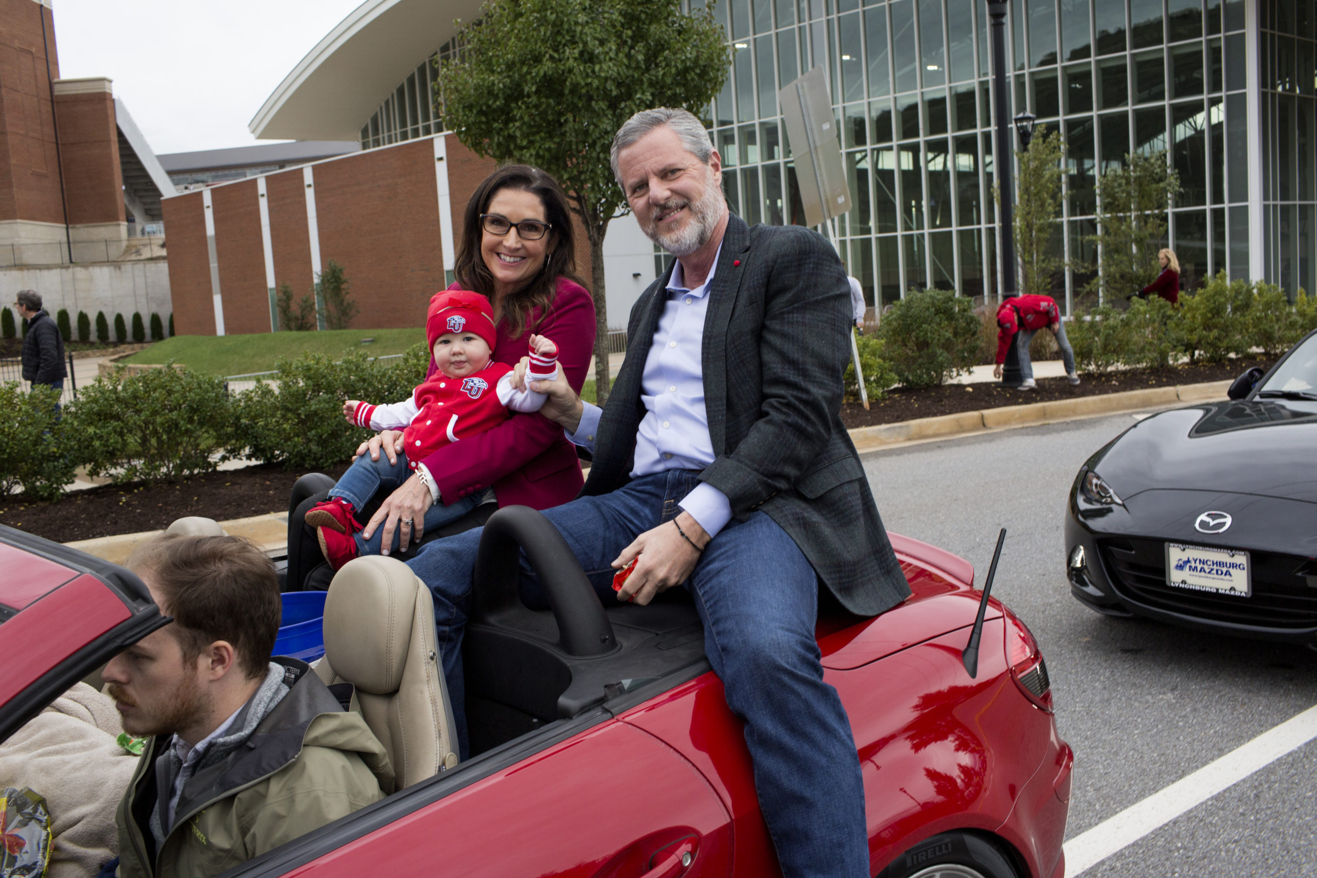 Then-President of Liberty University Jerry Falwell Jr. rides with his wife Becki and a grandchild in the school's annual homecoming weekend parade on October 20, 2018 in Lynchburg, Virginia.