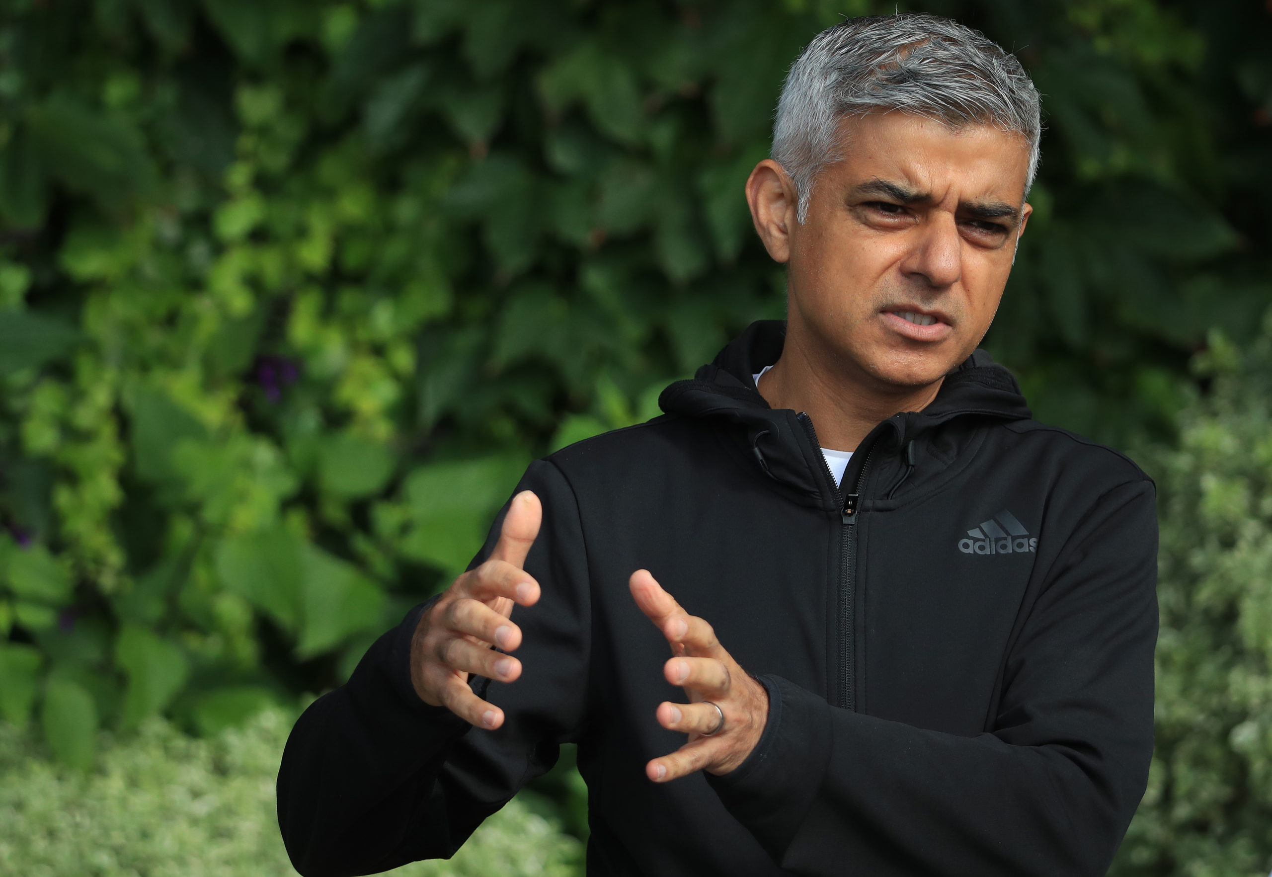 London mayor Sadiq Khan speaks to key workers at the All England Lawn Tennis Club at Wimbledon on September 4