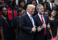 Jerry Falwell Jr, the-president of Liberty University, poses for photos with Donald Trump in 2017