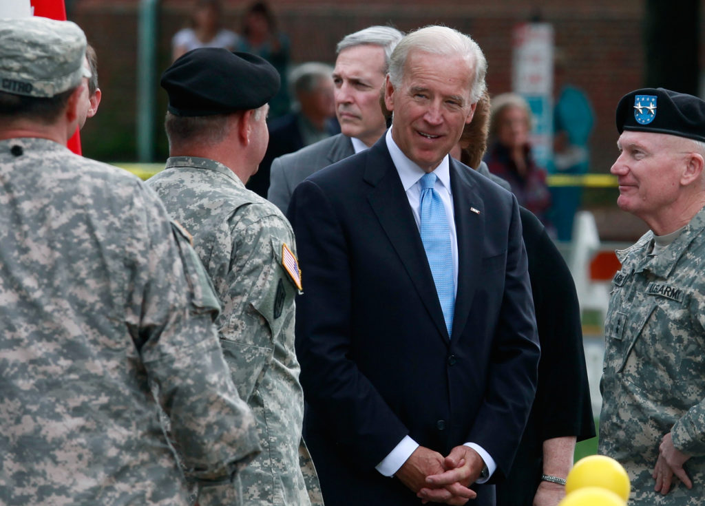 Then Vice President Joe Biden talks with members of the Delaware Army National Guard 261st Signal Brigade. (Mark Wilson/Getty Images)