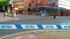 Law enforcement cordoned off the junction of Hurst Street and Bromsgrove Street after a string of stabbings that left 'a number of people' wounded. (Screen capture via Birmingham Live)