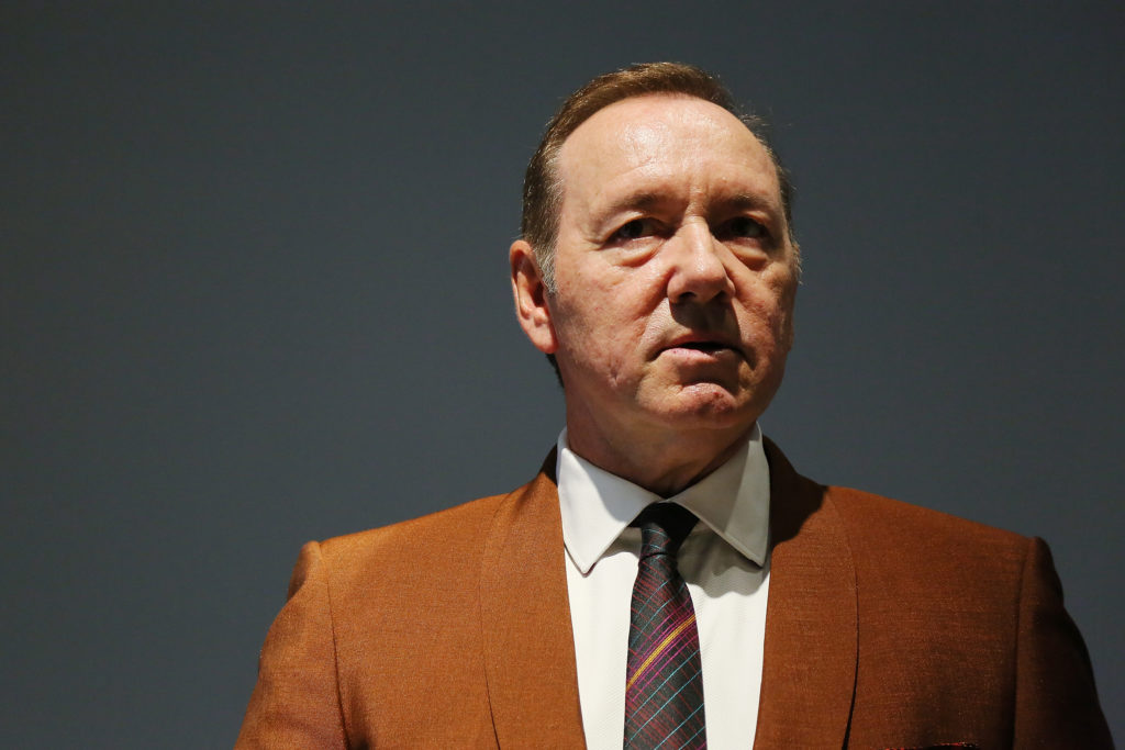 Kevin Spacey in an orange-brown suit