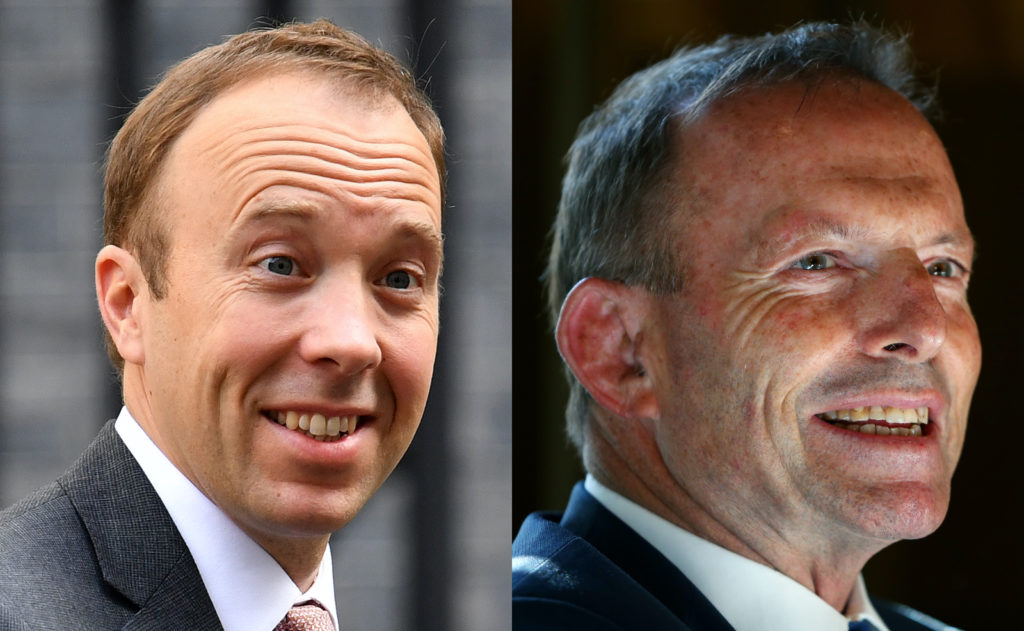Britain's health secretary Matt Hancock (L), fresh from defending marriage equality opponent Tony Abbott, gave himself a pat on the back for voting for same-sex marriage. (Getty)