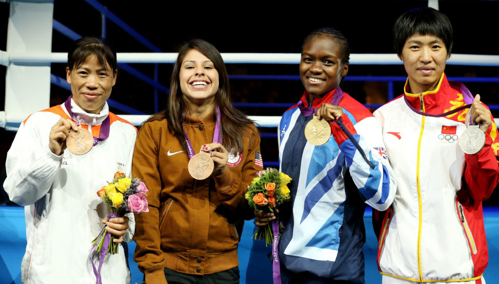 Nicola Adams, Marlen Esparaza and their two fellow Olympic champions holding medals at London 2012
