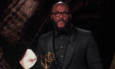 Tyler Perry holding his Emmy Award