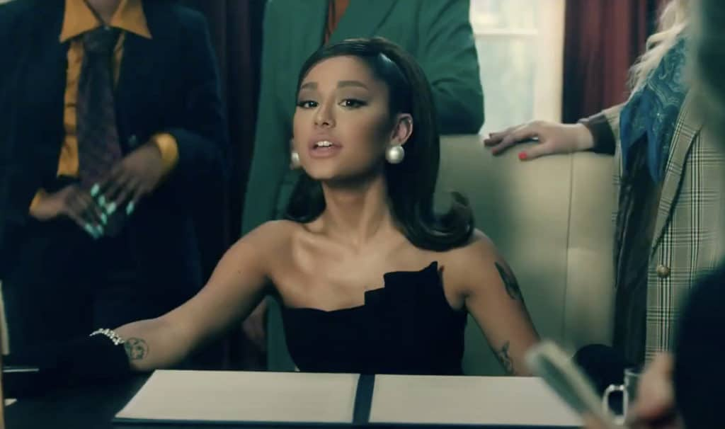 Ariana Grande juggled being US President and home life in the music video for her new song, 'Positions'. (Screen capture via YouTube)