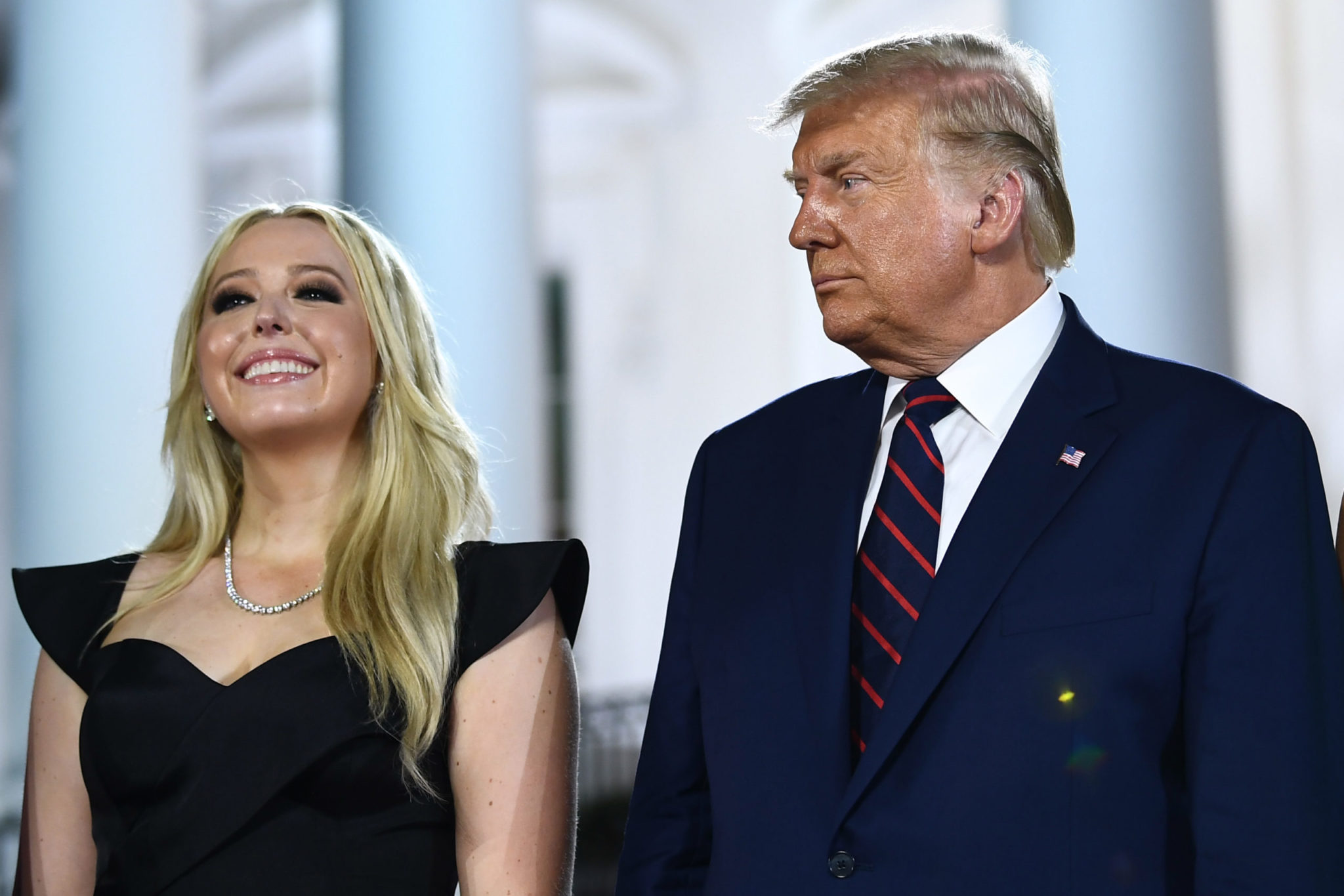 US President Donald Trump stands with daughter Tiffany Trump after he delivered his acceptance speech for the Republican Party nomination for reelection during the final day of the Republican National Convention at the South Lawn of the White House in Washington, DC on August 27, 2020.