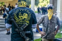 Armed members of the far-right Proud Boys group. (Nathan Howard/Getty Images)