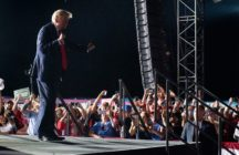 US President Donald Trump dances as he leaves a Make America Great Again rally as he campaigns at Orlando Sanford International Airport in Sanford, Florida, October 12, 2020.