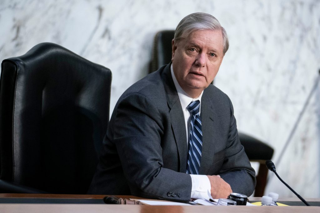 Senate Judiciary Committee Chairman Lindsey Graham questions President Donald Trumps Supreme Court nominee Judge Amy Coney Barrett during the third day of her confirmation hearing before the Senate Judiciary Committee on Capitol Hill on October 14, 2020