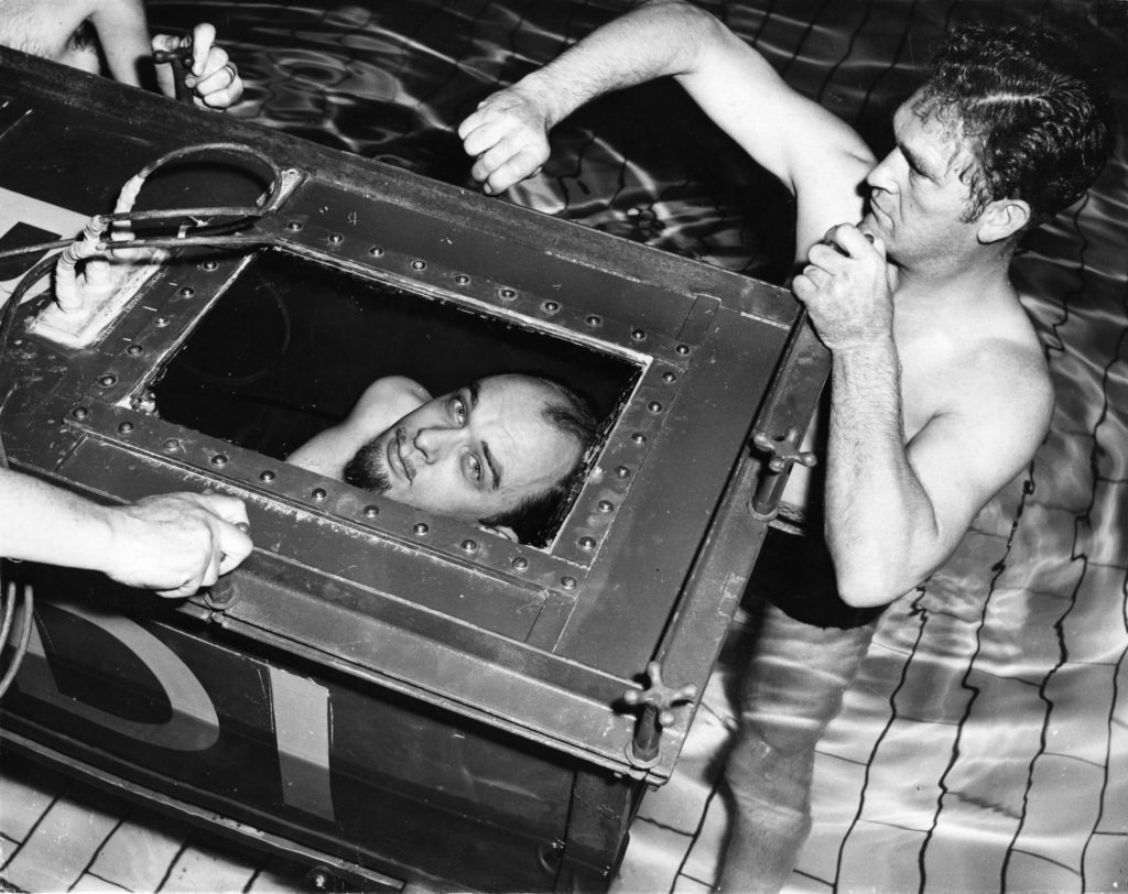 The Amazing Randi peers out from the sealed coffin in which he will attempt to break his own endurance record of staying two hours under water. (Ron Burton/Getty Images)