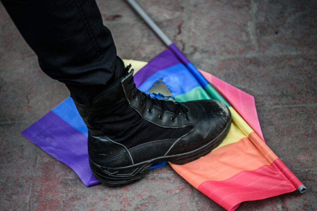 A Turkish anti-riot police officer steps on a rainbow flag during a rally staged by the LGBT community on Istiklal avenue in Istanbul on June 19, 2016. (OZAN KOSE/AFP via Getty Images)