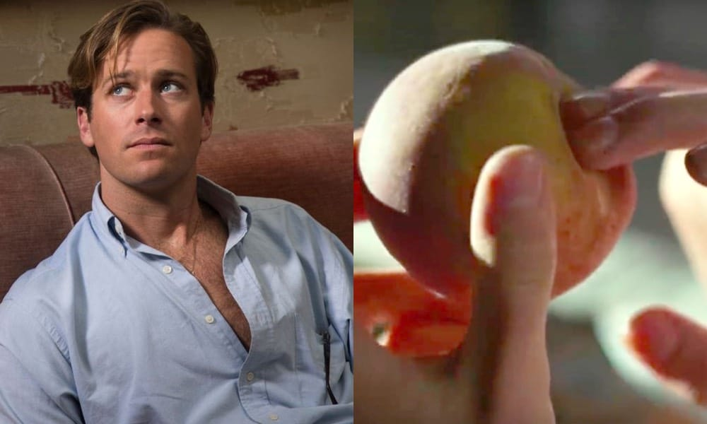Armie Hammer in a blue Oxford shirt unbuttoned to his navel / fingers going into a peach