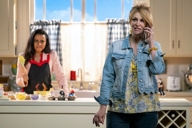 Jane Lynch wearing a denim jacket and classic short, spiky Karen hairstyle